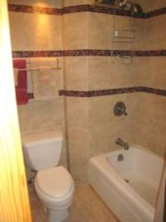 Glass mosaic accent tile at tub/shower
