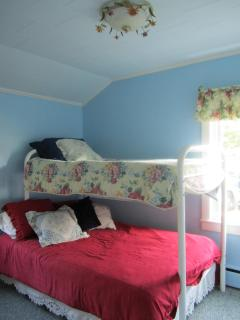 second bedroom with a lower double bed and single top bunk