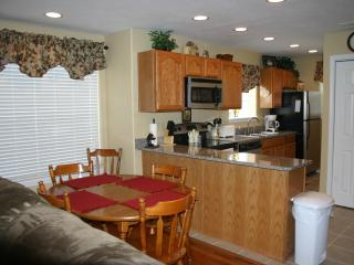 Dining room and Kitchen with granite counter top and Stainless Appliances