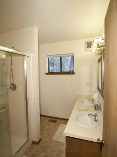 The downstairs bathroom has a large shower and twin sinks. Shampoo, soap, and hair dryer provided.