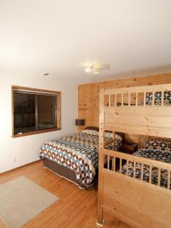 This upstairs bedroom has a double bed and a pair of twin beds.