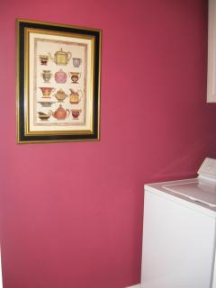 Laundry Room In the Home With Full Size Washer and Dryer  and Laundry Essentials