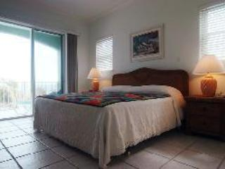 King size bed with full ocean view, opens to lanai