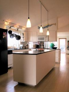 Large gourmet kitchen with brushed-stainless Bosch appliances.