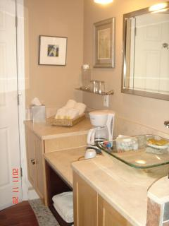 1/1 Bathroom counter with marble and glass sink