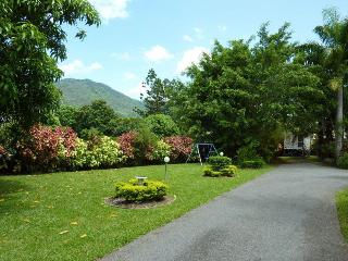 Views to mountain range and driveway into property parking.