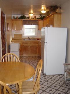 Kitchen with full size refridgerator, four burner stove top, micro and convection oven and more