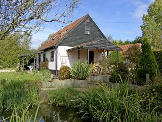 THE HAYBARN, pet friendly, country holiday cottage, with a garden in Necton, Ref