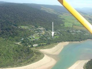 Aerial view of Papatowai, arrow shows accommodation location