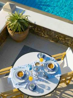 Breakfast by the pool at the House of the Sun, sea view