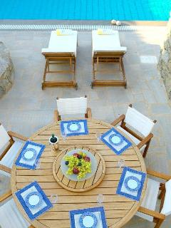 Dining table outside the House of the Sky by the pool. Second main dining area