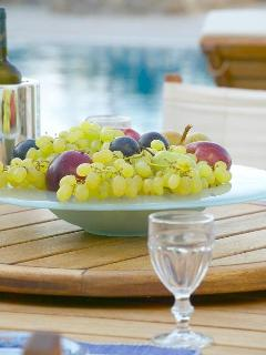 Fruit and Greek wine tasting by the pool with sea view