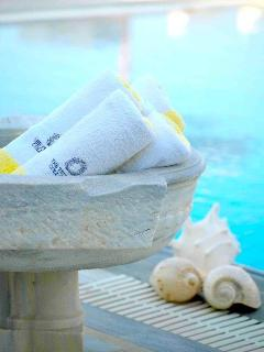 Pool towels with villa emblem provided in Greek and Chic style