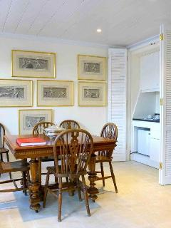 House of the Sky living and dining area with old Greek myth gravures font. Live your Myth in Greece!