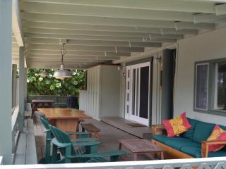 Covered lanai seating and dining area