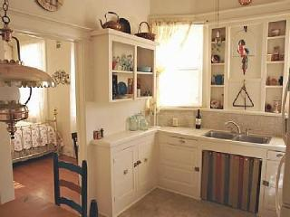 Kitchen counter and sink area;; viewed from Dining Table.  Open door leads to Den