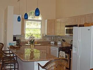 A cook's kitchen, in addition to lovely indoor/outdoor areas, invite memorable dining experiences.