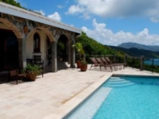 The inviting pool offers stunning views of Hurricane Hole and Tortola in the BVI.