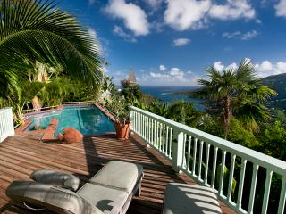 The large pool and deck is a private vacationland, with, hot tub, views and comfortable dining area.
