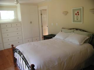 Master Bedroom, King Size bed, custom built closets, french doors to back yard and pond