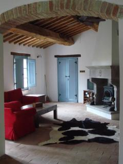 Open plan living with reclaimed floors and beams