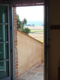 view from living room across balcony to the fields