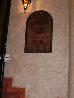 St. Michael graces the front entrance in authentic Mexican artwork painted on wood.