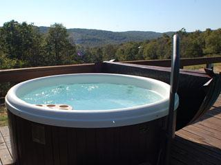 Sanctuary Suite's spacious hot tub overlooking the mountains.