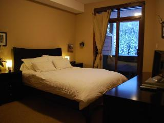 Master bedroom with access to outdoor patio with private hot tub.. Ski-in ski-out access to the slopes.