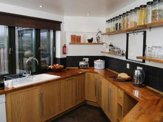 Bag End's oak kitchen is a pleasure to use, with access to the garden and outdoor dining area.