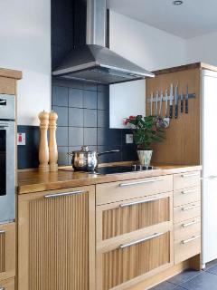 The kitchen is superbly fitted with Neff and Bosh appliances and is equipped to a high standard