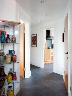 Lovely wide hallways and displays of vintage 20th Century ceramics add a little quirky style.