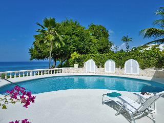 A well appointed beachfront four bedroom villa