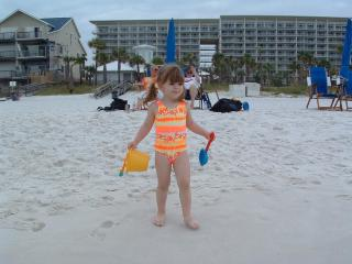 Precious on the beach with our condo just behind her.