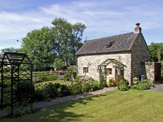 CHURCH BARN, romantic, character holiday cottage, with open fire in Fenny