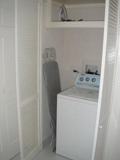 Closet with washing machine, ironing board etc