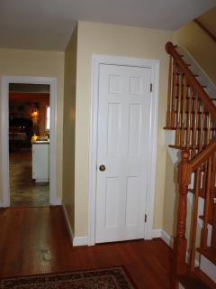 Foyer with oak hard wood flooring and stair case