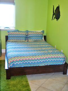 Queen platform bed in guest bedroom - plus twin/twin bunk and  private bathroom, view of lagoon