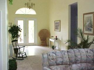 inside foyer of home leading to family room - high ceilings and fans throughout