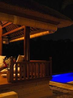 Sitting/Massage Bale at night with blue illuminated pool in the background