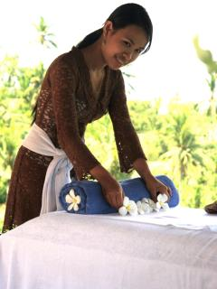 Santai's Staff Member Preparing the Massage Table