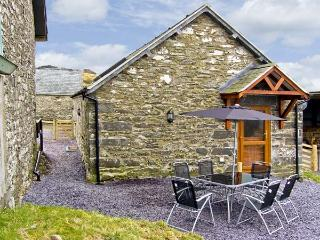 TY ISAF PENRHYDDION, pet friendly, country holiday cottage, with a garden in