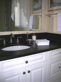 Master Bath Vanity With Honed Granite Tops, Hairdryer.
