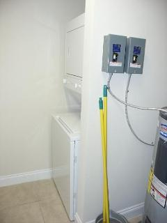 Stack Washer and Dryer in Utility Room