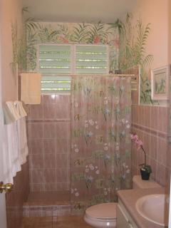 This sunny full bath is located in the main cottage