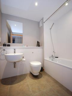 Family bathroom with bath, shower and complimentary toiletries