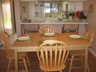 Dining table extends to seat 6. Well-stocked kitchen and refrigerator with in-door water/ice.