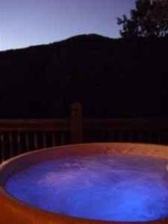www.blueridgeparkwaycabinrentals.com  Our cabin's hot tub on the porch with mountain view