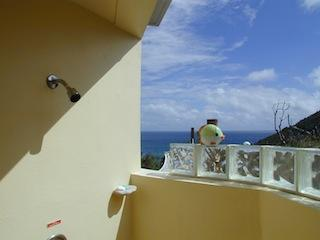 one of our architect-designed indoor-outdoor showers with private views of the Caribbean