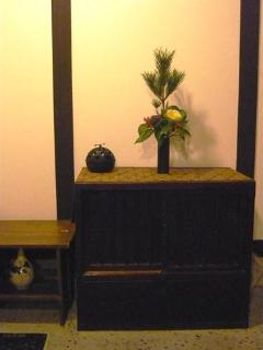 Japanese chest and flower arrangement